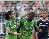 Goal celebration by Seattle Sounders FC forward Eddie Johnson (7): goal, and Seattle Sounders FC midfielder Mauro Rosales (10): assist. In a Major League Soccer (MLS) match, the New England Revolution tied the Seattle Sounders FC, 2-2, at Gillette Stadium on June 30, 2012.