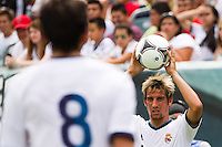 Fabio Coentrao (15) of Real Madrid on a throw in. Real Madrid defeated Celtic F. C. 2-0 during a 2012 Herbalife World Football Challenge match at Lincoln Financial Field in Philadelphia, PA, on August 11, 2012.
