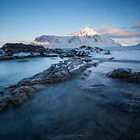 Tital rocks at Skagsanden beach in winter, Flakstadøy, Lofoten Islands, Norway