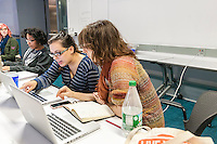Arielle Martinez, left and Jane Friedhoff, right,  collaborate on developing computer games at a game jam at NYU-Poly in downtown Brooklyn in New York on Sunday, September 29, 2013. With women making up only 4 percent of game developers the Code Liberation project at NYU-Poly invited women coders of different skill levels to participate in a weekend long game jam to encourage more women to enter the tech fields. Over 20 women participated, working in teams to develop their games.  (© Richard B. Levine)