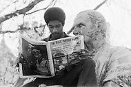 New Haven, CT. May 2nd 1970 Yale University.<br /> A member of the Black Panthers reads an issue of &quot;The Black Panther&quot; while sitting on a statue of former Yale University president Theodore Dwight Woolsey during a protest at Yale University. Yale students and protesters from around the US are demonstrating in support of the Black Panther Party while several party leaders, including its cofounder Bobby Seale, are on trial.