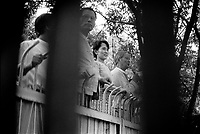 Daw Aung San Suu Kyi, the Nobel Peace Prize Laureate and General Secretary of the National League for Democracy (NLD), addressing supporters at the gates to her home. She is pictured with with U Tin Oo (left), then Deputy Chairman of the NLD, and the late U Kyi Maung (right).