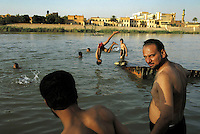 Iraqis bathe in the Tigris River in Baghdad, 2004.