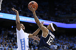 28 December 2016: Monmouth's Justin Robinson (12) and North Carolina's Kennedy Meeks (3). The University of North Carolina Tar Heels hosted the Monmouth University Hawks at the Dean E. Smith Center in Chapel Hill, North Carolina in a 2016-17 NCAA Division I Men's Basketball game. UNC won the game 102-74.
