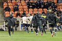 Houston, TX - Friday December 9, 2016: The Wake Forest Demon Deacons team rushes the field after Ian Harkes (16) game winning goal in overtime against the Denver Pioneers  at the  NCAA Men's Soccer Semifinals at BBVA Compass Stadium.
