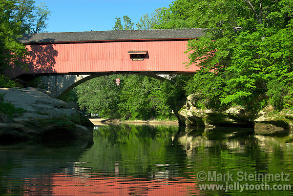 View looking upstream at the narrows covered bridge built in 1883 by