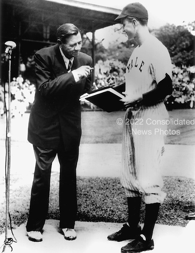"""New Haven, Connecticut - Undated file photo -- On behalf of Yale University, Yale Baseball Captain George Bush accepts """"The Babe Ruth Story"""" autobiography from Babe Ruth in 1948..Credit: White House via CNP"""