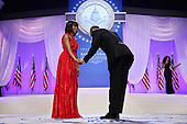 United States President Barack Obama bows to first lady Michelle Obama before they dance during the Inaugural Ball at the Walter Washington Convention Center January 21, 2013 in Washington, DC. President Obama started his second term by taking the Oath of Office earlier in the day during a ceremony on the West Front of the U.S. Capitol.  .Credit: Chip Somodevilla / Pool via CNP