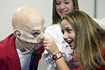 10/07/04 ecenter21 metro.Emily Weaver, dressed as Hurbert Bobmin, Presidential Candidate for the Peace party, has her nose tweeked by classmate Adrianna Bernal as MacKenzie Harrington (middle) looks on. The Islander Middle School eight graders were part of a social studies class using Storypath, an educational program in which they create an election campaign, with candidates, platforms and posters. (Jim Bryant/P.I. Photo)