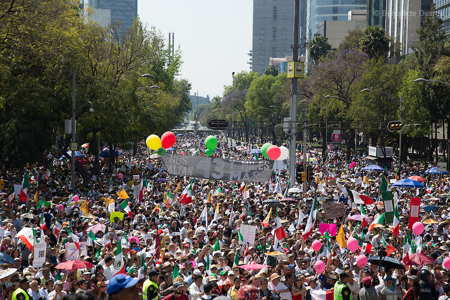 Thousands hold Mexican flags and signs against US President Donald Trump during an anti-Trump march in Mexico City, Mexico on February 12, 2017. Photo by Bénédicte Desrus