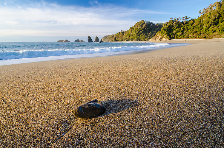 A single rock on a pristine pebble beach on the West Coast of the South Island, New Zealand - stock photo, canvas, fine art print