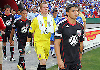 Jaime Moreno #99 of D.C. United leads the team onto the field during an international charity match against the national team of El Salvador at RFK Stadium, on June 19 2010 in Washington DC. D.C. United won 1-0.