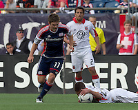 DC United defender Perry Kitchen (23) awarded yellow card as he gathers in loose ball away from New England Revolution midfielder Kelyn Rowe (11).  In a Major League Soccer (MLS) match, DC United defeated the New England Revolution, 2-1, at Gillette Stadium on April 14, 2012.