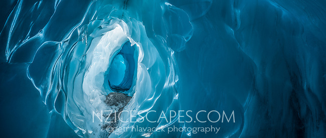 Amazing textures and shapes of blue ice tunnel, cave on Franz Josef Glacier, Westland Tai Poutini National Park, West Coast, UNESCO World Heritage Area, South Westland, New Zealand, NZ
