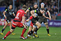 Henry Thomas of Bath Rugby takes on the Toulon defence. European Rugby Champions Cup match, between Bath Rugby and RC Toulon on January 23, 2016 at the Recreation Ground in Bath, England. Photo by: Patrick Khachfe / Onside Images