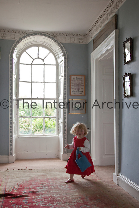 One of the Fennell children running through the rooms of Burtown House