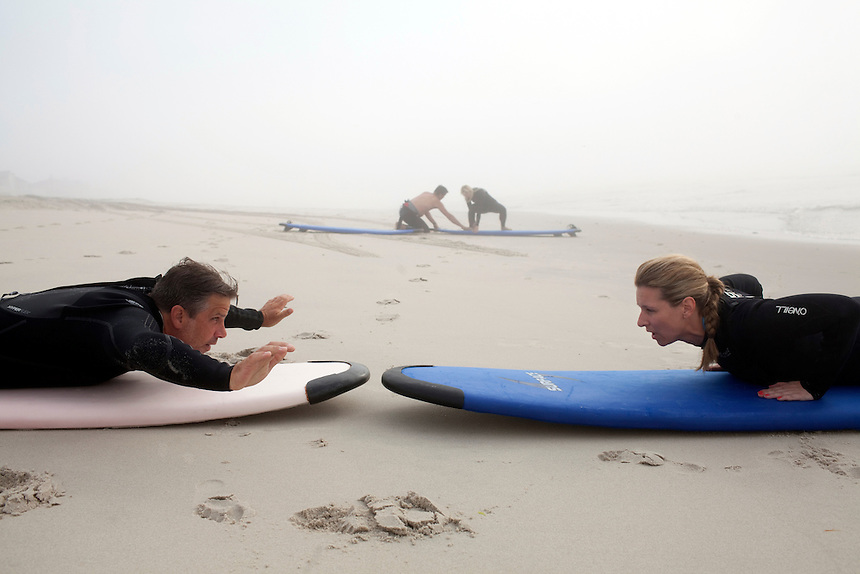 Long Beach Island, NJ - June 30, 2013 : Surfing instructor Eric Leonard teaches Lila Walerych, from New York how to surf during a lesson on Brighton Beach, Long Beach Island, NJ on June 30, 2013. People are returning to the beaches for the summer after recovery efforts post Superstorm Sandy.
