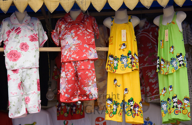 Souvenir stall selling clothing to passing tourists in Fengdu, China