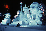 These are not traditional Frosty the Snowmen, but huge carved and chiseled Samurai Warriors, Buddhists gods, historical heroes of fairy tales and Walt Disney characters. Some stand as big as buildings. Chiseled out of tons of packed snow, the sculptures are the pride and job of the residents of Sapporo, Japan, who hosts the world famous Ice and Snow Sculpture Festival for five days in early February.Themes of the sculptures are picked from Kabuki stages, historical characters or fairy tales. (Jim Bryant Photo).....