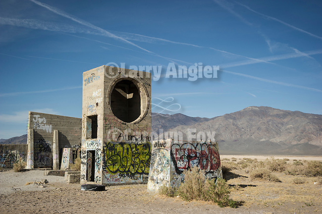 Round window, graffiti on old concrete ruins by U.S. Highway 95 in Tonopah Junction, Nevada