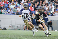 Annapolis, MD - April 15, 2017: Army Black Knights Cole Johnson (28) avoids Navy Midshipmen Chris Fennell (10) during game between Army vs Navy at  Navy-Marine Corps Memorial Stadium in Annapolis, MD.   (Photo by Elliott Brown/Media Images International)