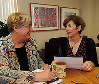 Dane County executive Kathleen Falk (right) discusses her alcohol initiative with staff member Carol Lobes on Friday in Madison