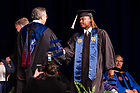 May 21, 2017; Former football player Cole Luke receives his diploma from Dean Roger Huang during the Mendoza College of Business undergraduate Commencement ceremony, 2017. (Photo by Matt Cashore/University of Notre Dame)