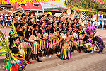 A school group poses for photographs after their street dance performance at the opening of the Bulihan Fiesta in Sampaloc, Quezon Province, the Philippines.  (April 2012)