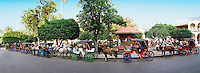 Horse drawn taxis in front of the Central Park in Granada, Nicarauga.