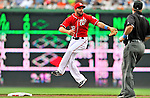 19 June 2011: Washington Nationals' infielder Danny Espinosa is unable to come up with an errant throw from Ryan Zimmerman allowing Derrek Lee to take third base in the second inning of play against the Baltimore Orioles at Nationals Park in Washington, District of Columbia. The Orioles defeated the Nationals 7-4 in inter-league play, ending Washington's 8-game winning streak. Mandatory Credit: Ed Wolfstein Photo