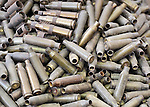 Bullet casings piled up in Misrata, Libya. Months of fighting in Misrata have left an abundance of ordnance scattered all over the city, some of which has been gathered by residents and placed in displays in front of buildings and in public spaces such as parks. Yet these museums include some extremely dangerous unexploded ordnance, and an ordnance disposal team from the ACT Alliance is working with local residents and city officials to neutralize the threat posed to civilians by the war debris.