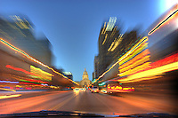 Buildings leave trails and streaks during this time exposure on Congress Avenue heading to the Texas State Capitol in downtown Austin, Texas, USA.