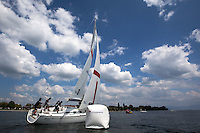 Adam Minoprio rounds the windward mark during day 3 of Match Race Germany 2010. World Match Racing Tour. Langenargen, Germany. 22 May 2010. Photo: Gareth Cooke/Subzero Images/WMRT