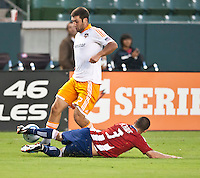 CARSON, CA – July 23, 2011: Houston Dynamo forward Will Bruin (12) and Chivas USA defender Heath Pearce (3) during the match between Chivas USA and Houston Dynamo at the Home Depot Center in Carson, California. Final score Chivas USA 3, Houston Dynamo 0.