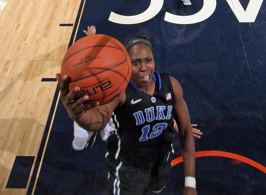 Duke guard Chelsea Gray (12) shoots the ball during an NCAA college basketball game in Charlottesville, Va. Duke defeated Virginia 62-41...