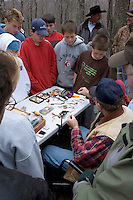 Elementary school students from Gwinn Michigan get a fly tying lesson as part of their Salmon in the Classroom studies.