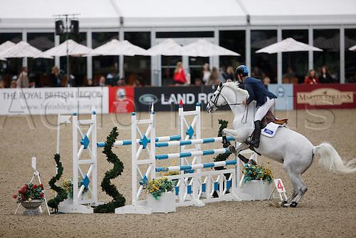 14.05.2011. Windsor, Berkshire, England. Royal Windsor Horse Show. Daniel Mosley on Billy Laden
