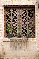 Wrought iron window in Fabrica La Aurora Art and Design Center, San Miguel de Allende, Mexico. San Miguel de Allende is a UNESCO World Heritage Site....