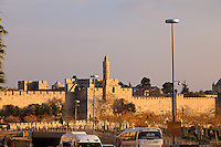 Traffic on Jerusalem's Jaffa Street passes along the walls of the Old City of Jerusalem.