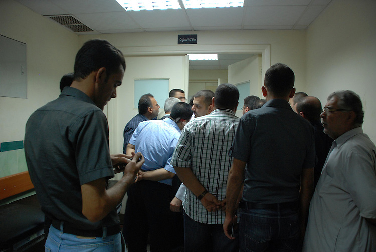 KIRKUK, IRAQ:  Men gather in the Kirkuk hospital after a bloody shootout between the police and a gang of thieves. ..A shoot out between police and a gang of thieves left 10 dead and 16 wounded in the Iraqi city of Kirkuk.  The armed thieves were trying to rob a number of stores in the city's gold market when the police open fired on them...Photo by Hawre Khalid/Metrograpgy