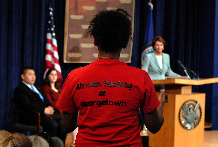 Haden Fecadu, a Georgetown junior, waits to ask House Minority Leader Nancy Pelosi, D-Calif., a question during a speech she gave at the university.  Pelosi addressed the economy, genocide in darfur, AIDS in Africa, and the Mark Foley scandal.