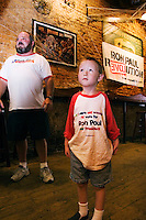 Bryan Morton and his son, Fletcher Morton, age 6, support Republican candidate Ron Paul at Paulapalooza, a grassroots rally at One Eyed Jacks in downtown Orlando, Florida the day of the Republican presidential debate, October 21, 2007.