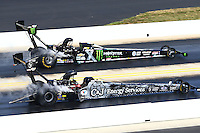 Sep 20, 2015; Concord, NC, USA; NHRA top fuel driver Larry Dixon (near) races alongside Brittany Force during the Carolina Nationals at zMax Dragway. Mandatory Credit: Mark J. Rebilas-USA TODAY Sports