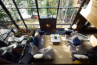 View from the mezzanine over the living area which has floor-to-ceiling windows with views over the lake