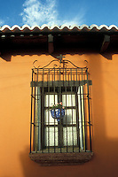 Barred window of a restored Spanish colonial house in Antigua, Guatemala