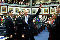 TALLAHASSEE, FLA. 3/5/13-OPENING030513CH-Gov. Rick Scott, center, waves to someone in the House Gallery as he enters to give the State of the State address during the opening day of the 2013 legislative session Tuesday at the Capitol in Tallahassee, Fla...COLIN HACKLEY PHOTO