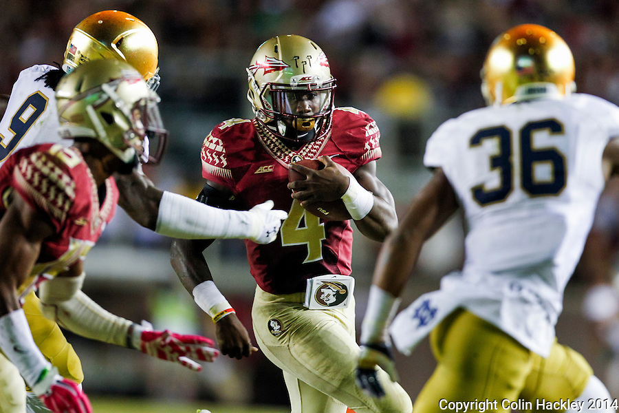 TALLAHASSEE, FLA. 10/18/14-FSU-ND101814CH-Florida State's Dalvin Cook runs against Notre Dame's during second half action Saturday at Doak Campbell Stadium in Tallahassee. The Seminoles beat the Fighting Irish 31-27.<br /> COLIN HACKLEY PHOTO