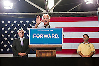 Vice President Joe Biden, flanked by Secretary of Agriculture Tom Vilsack, left, and Bruce Scheitlen, president of UAW Local 1237, speaks at a campaign rally at the Port of Burlington during a two-day campaign swing through Iowa on Monday, September 17, 2012 in Burlington, IA.