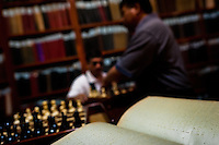 Blind men play chess in the library of Unión Nacional de Ciegos del Perú, a social club for the visually impaired in Lima, Peru, 5 April 2013. Unión Nacional de Ciegos del Perú, one of the first societies for disabled in Latin America, was established in 1931 to provide a daily service for blind and partially sighted people from the capital city. The range of activities includes reading books in a large Braille library, playing chess or using a computer adapted for visually impaired individuals. As the majority of the blind does not have a regular job, the UNCP club offers them an opportunity to learn and lately, to provide massages to the club visitors and thus generate some income.