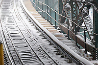 Snow covered tracks in the Queensboro Plaza station in New York during Winter Storm Jonas on Saturday, January 23, 2016. Due to blizzard conditions approaching the MTA announced they will be suspending all above ground subway service as of 4:00 PM. (© Richard B. Levine)